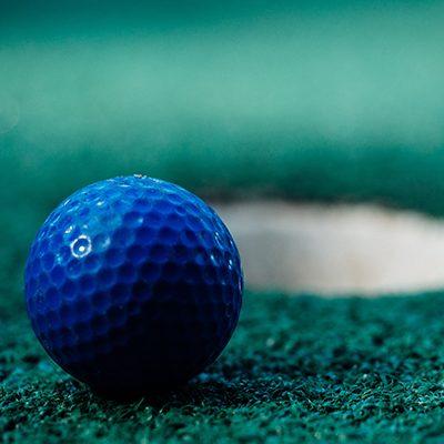 blue golf ball on green