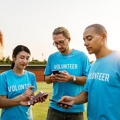 volunteers in group looking at phones