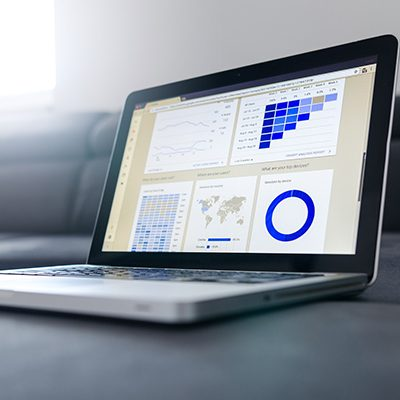 laptop with graphs and charts
