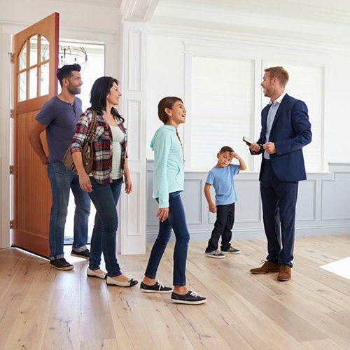 Realtor Showing Hispanic Family Around New Home